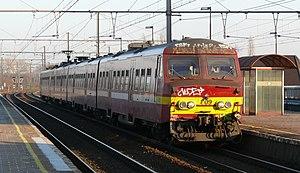 Belgian railway line 25 - NMBS 809 (type MS75) arrives at platform 4 of Mechelen Nekkerspoel station in 2012