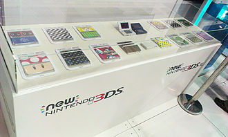 New Nintendo 3DS - Display case featuring the New Nintendo 3DS and face plates at PAX Australia 2014.