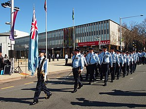 Members of No. 28 Squadron RAAF pass by Civic Square during the unit's Freedom of the City parade in August 2013