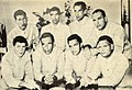 North Korean Propaganda Photograph of prisoners of the USS Pueblo, with the Hawaiian Good Luck Sign, 1968 (cropped).jpg