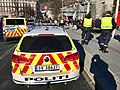 Norwegian police officers and Volkswagen and Mercedes-Benz cars with high-visibility vehicle markings and design in Christies gate, Bergen, Norway 2018-03-17 (utrykningspolitiet holder vakt under folkearrangement).jpg