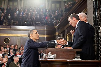 2011 State of the Union Address - U.S. President Barack Obama is greeted by House Speaker John Boehner, before delivering the 2011 State of the Union Address.