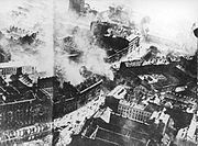 Warsaw's downtown burning after an air raid by the Luftwaffe, 1939.