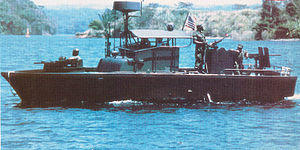 Operation Game Warden - PBR on patrol in Vietnam with its front facing .50-caliber machine gun, rear facing .30-caliber machine gun, and 40-mm grenade launcher clearly visible