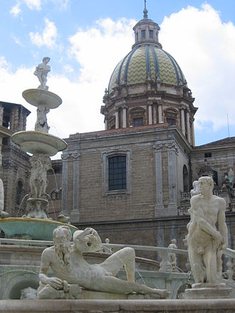 Sicilian Baroque - Illustration 5: Piazza Pretoria, Palermo. The fountain (circa 1554) by Francesco Camilliani is the only example of high Renaissance art in the capital city. Dominating the piece is the Church of Santa Caterina (circa 1556), with its spectacular later Baroque dome.