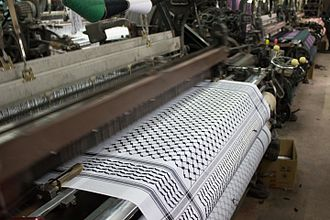 Keffiyeh - A loom at work making a traditional Palestinian keffiyeh in the Hirbawi factory, Hebron, West Bank