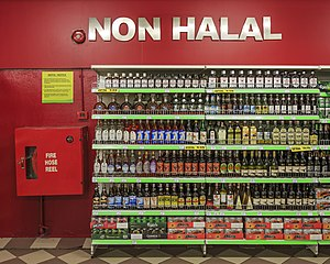 "Alcohol in Malaysia - Alcoholic drinks been put in a separate storage places with a label ""non-halal"" in the Giant Supermarket of Sabah."