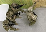 Paratroopers, Lithuanian soldiers navigate shoot house 170201-A-DP178-245.jpg