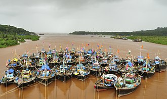Fishing boats parked in the Anjarle creek for the monsoon season. Fishing in the coastal areas is not possible now due to the harsh weather conditions. Parked boats at Anjarle Creek.jpg