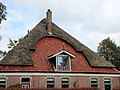 Partially thatched roof.jpg