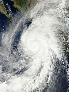An exceptionally well-developed hurricane located southwest of Mexico. The storm features a well-defined, clear eye surrounded by a large, mostly symmetric ring of clouds. Prominent bands of cloud cover extend north and south of the storm center.
