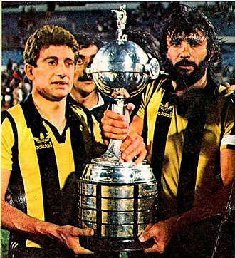 Copa Libertadores - Fernando Morena (left) and Walter Olivera holding the trophy won in 1982