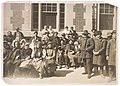 Photograph of a Group of Immigrants Outside a Building on Ellis Island - NARA - 595669.jpg