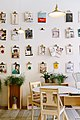 Pictures on wall with table (Unsplash).jpg