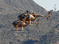 Pilots in MD-530F training helicopters prepare to land at Redstone Arsenal, Ala., Aug. 31, 2012 120831-A-ZZ999-626.jpg