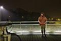 Pink human standing on Passerelle de la Woluwe (pedestrian bridge in Woluwe-Saint-Pierre, Belgium) at night (DSCF2553).jpg