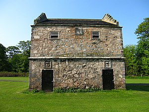 Alexander Seton, 1st Earl of Dunfermline - Doocot (English 'Dovecote') at Pinkie House with Seton's characteristic cipher of a crowned crescent and cinquefoil over door to right