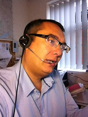 Headset (audio) - A user wearing a monoaural Plantronics headset.