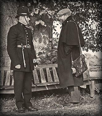 History of law enforcement in the United Kingdom - Victorian Police Officer with itinerant circa 1900 - recreation. The officer is pictured wearing a duty armband on his left wrist.
