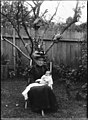 Portrait of a seated woman in Edwardian dress, with baby (3310892986).jpg