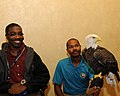 Posing for picture with Bald Eagle. (10595195664).jpg