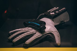 Power Glove - A Power Glove in the collection of the Video Game Museum, Berlin, Germany.