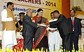 Pranab Mukherjee presenting the National Award for Teachers-2014 to Shri Bhumidhar Baruah, Arunachal Pradesh, on the occasion of the 'Teachers Day', in New Delhi. The Union Minister for Human Resource Development.jpg