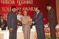 Pranab Mukherjee presenting the Tourist Friendly Railway Station Award to Mysore Railway Station, Mysore division of South Western Railway received by the Division Railway Manager (DRM) of Mysore Railway Division.jpg