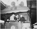 President Harry S. Truman on the rear platform of the presidential train, speaking to two unidentified men. Truman... - NARA - 199936.tif