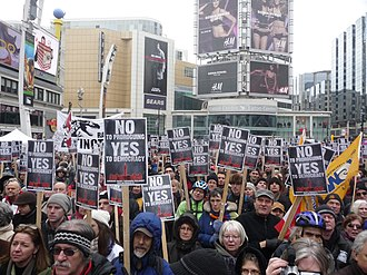 2010 Canada anti-prorogation protests - Protesters holding picket signs in Toronto.
