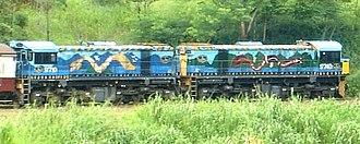 Djabugay - Buda-dji painted onto the front the Queensland Rail engine ascending the Barron Gorge, to Kuranda