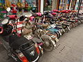 Qufu - electric bikes parked - P1060310.JPG