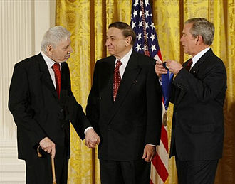 Sherman Brothers - The Sherman Brothers receive the National Medal of Arts, the highest honor bestowed upon artists from the United States Government.  Left to right:  Robert B. Sherman, Richard M. Sherman and U.S. President George W. Bush at The White House, November 17, 2008.