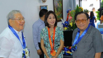 Gwendolyn Garcia - Rep. Garcia with House of Representatives Speaker Feliciano Belmonte (left) and her father, former Representative Pablo P. Garcia (right).