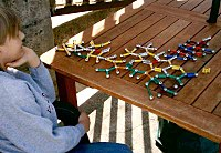 Those with AS often display intense interests, such as this boy's fascination with molecular structure.