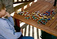 People with Asperger's Syndrome are often preoccupied with particular, specialized areas of knowledge, such as this boy's interest in molecular structure.