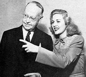 Rita Corday - Rita Corday (right) with film writer and critic Norbert Lusk (1946)