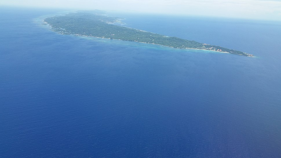 Roatan looking northwest with West Bay on the right and Coxen Hole and Manuel Galvez airport in the upper middle