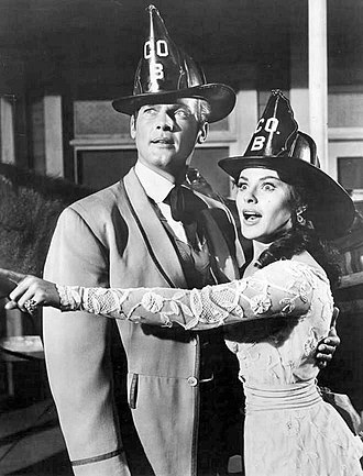 Maverick (TV series) - Roger Moore and Kathleen Crowley, 1961.