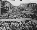 Rows of bodies of dead inmates fill the yard of Lager Nordhausen, a Gestapo concentration camp. This photo shows less... - NARA - 531259.tif