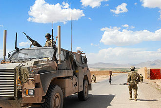 Airfield Defence Guards - RAAF security force personnel patrolling through Tarin Kowt in Afghanistan during 2013