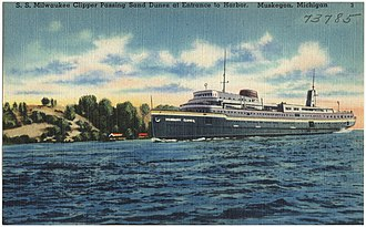SS Milwaukee Clipper - The ship passing sand dunes at the entrance to the harbor in Muskegon.