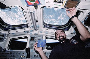 Umberto Guidoni - First European on board the ISS shows EU flag