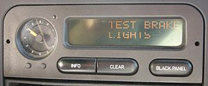 Saab Information Display - SID-2 in a 1995 Saab 900SE, showing check warning and some pixel failure.