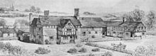 A black-and-white drawing showing a farm from a slightly elevated angle.  The farmhouse is to the left and has a protruding bay with a timber-framed gabled upper storey; a farm building is at a right-angle on the right, and its upper storey is entirely timber-framed.