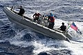 Sailors maneuver a rigid-hull inflatable boat. (35423605361).jpg