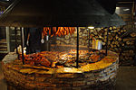 Texas-style barbecue smoke pit with various meats