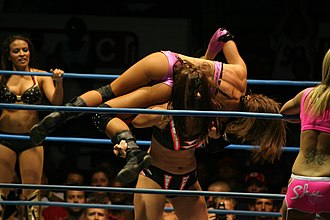 Sarah Stock - Sarita applying a La Reienera on Ms. Tessmacher