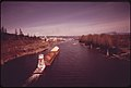 Sawdust Barge in Camas Slough near Opening to Columbia River 04-1973 (4271659427).jpg