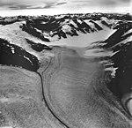 Sawyer Glacier, tidewater glacier with dark medial moraine and firn line, hanging glacier on the mountainside, August 27, 1968 (GLACIERS 5889).jpg